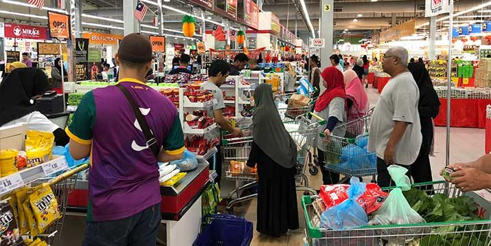 Wary consumers rein in spending